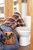 Contractor installing a toilet